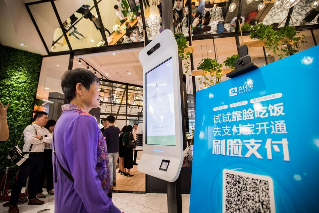 "A customer tries Alipay's facial recognition payment solution ""Smile to Pay"" at KFC's new KPRO restaurant in Hangzhou"