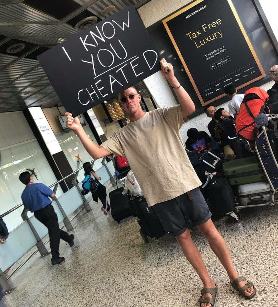Man Gets Revenge On Cheating Girlfriend With Sign At Airport-8979