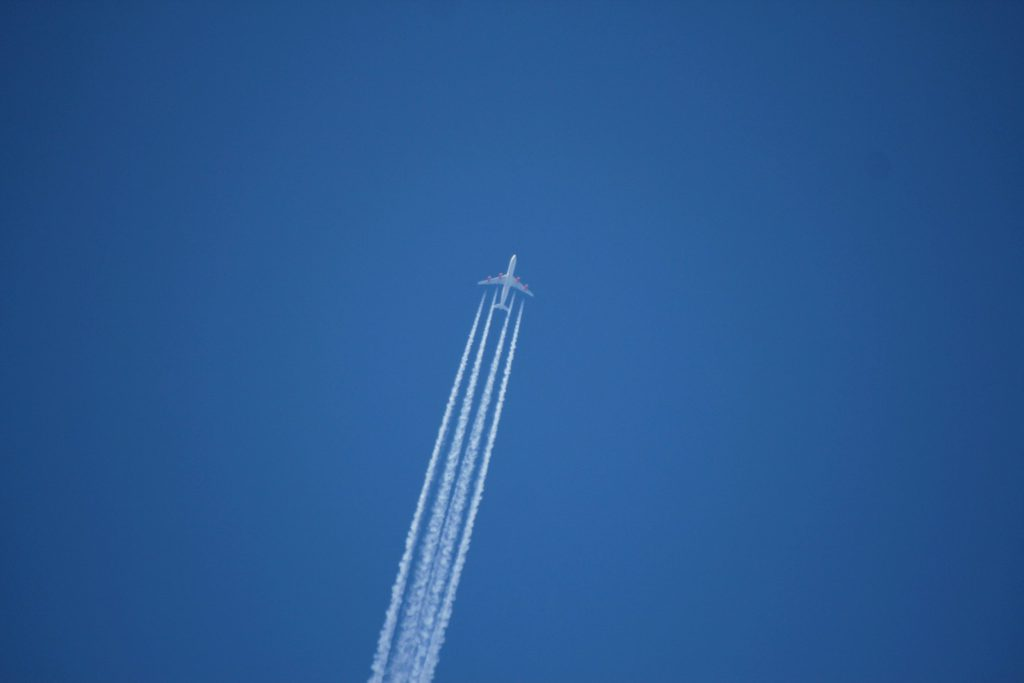 Jet leaving a white trail in air