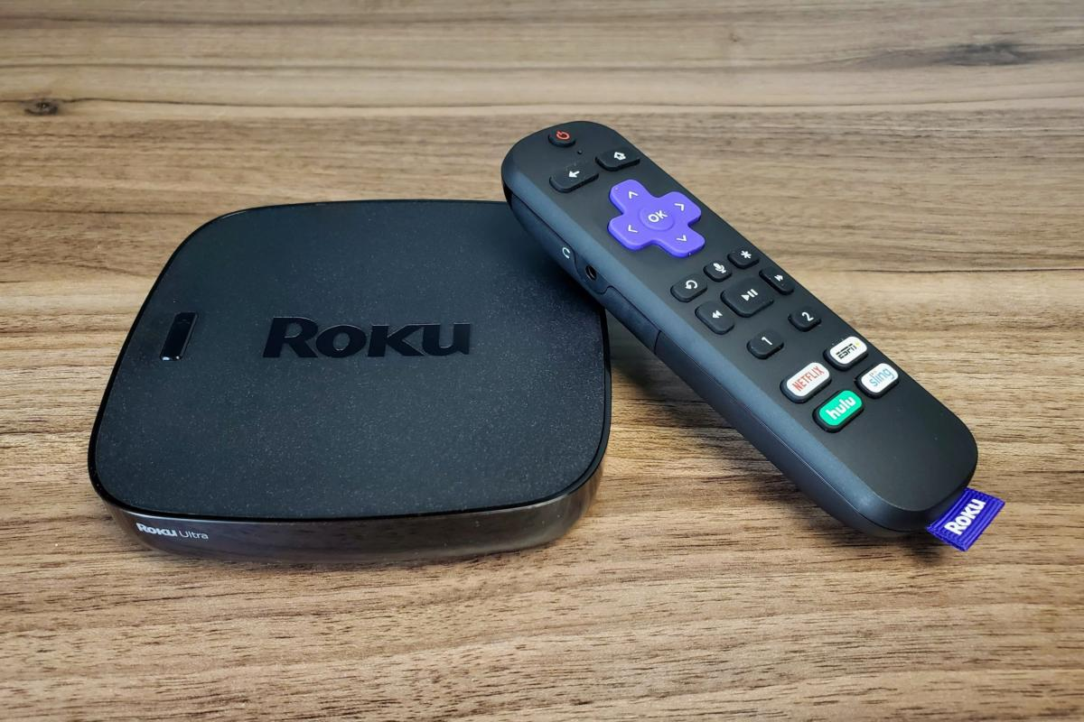Roku Ultra streaming player and a remote