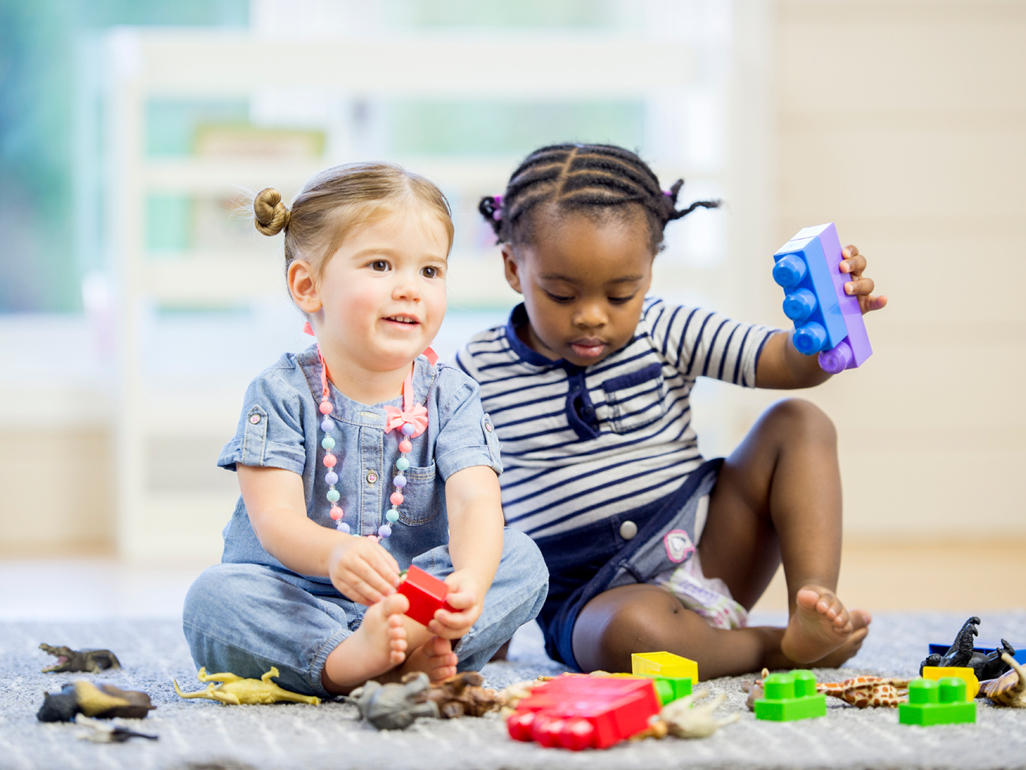 Children playing with plastic toys